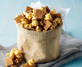 peanut butter snack mix with post shreddies cereal and popcorn and nuts add some raisins
