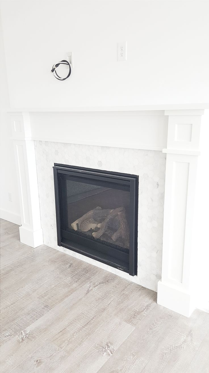 #whitelanedecor @whitelanedecor White wash wood floor, hexagon marble fireplace, craftsman fireplace mantel.