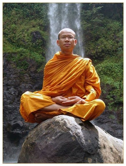 Meditation by a monk in front of a waterfall in Pakse, Laos. http://viaggivietnam.asiatica.com/