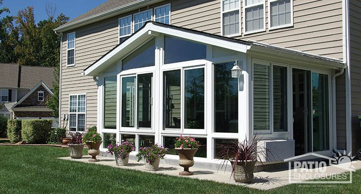 Looking for a four season vinyl sunroom? Take a look at this Patio Enclosures sunroom in white with shingled gable roof with glass wings and glass knee wall. #sunrooms #homeimprovement