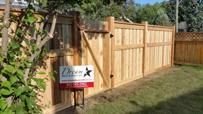 Fully Custom Cedar fortress fence with overlapped fence boards NO GAPS for absolute privacy, 6x6 posts and 2x6 framing what a sharp looking fence. www.dreamdeckandfence.ca