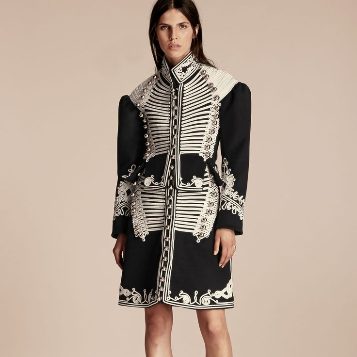 A deftly crafted wool Burberry coat cut for an authentic military-style silhouette and adorned with over 100 metres of English-woven regalia and decorative domed buttons. Cut to precision, it is adapted with a corset-inspired cut-out peplum waist while sleeves are puffed for pronounced shoulders.