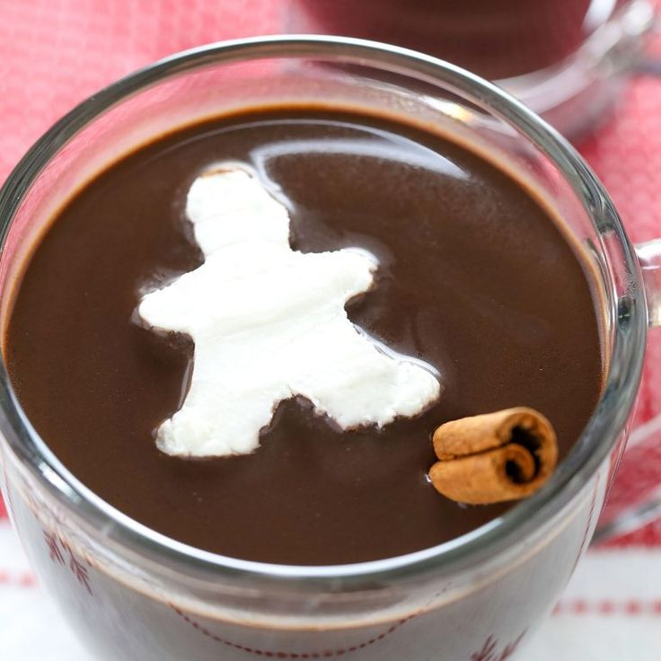 This recipe for Gingerbread Hot Chocolate complete with adorable gingerbread men whipped cream cubes is the perfect warm drink for a cold day.