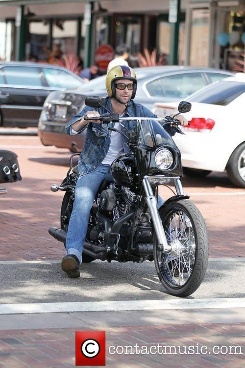 Adam Levine out and about on his motorcycle...