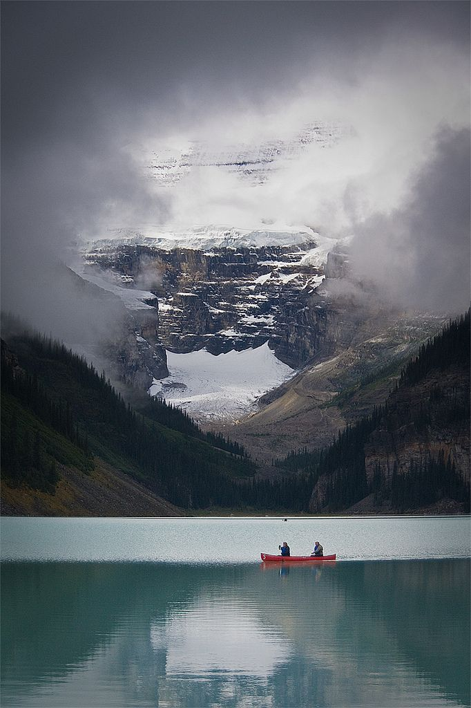 A Break in the Clouds - Canoeing on beautiful Lake Louise in Alberta Canada (photo by Jeff Pang)
