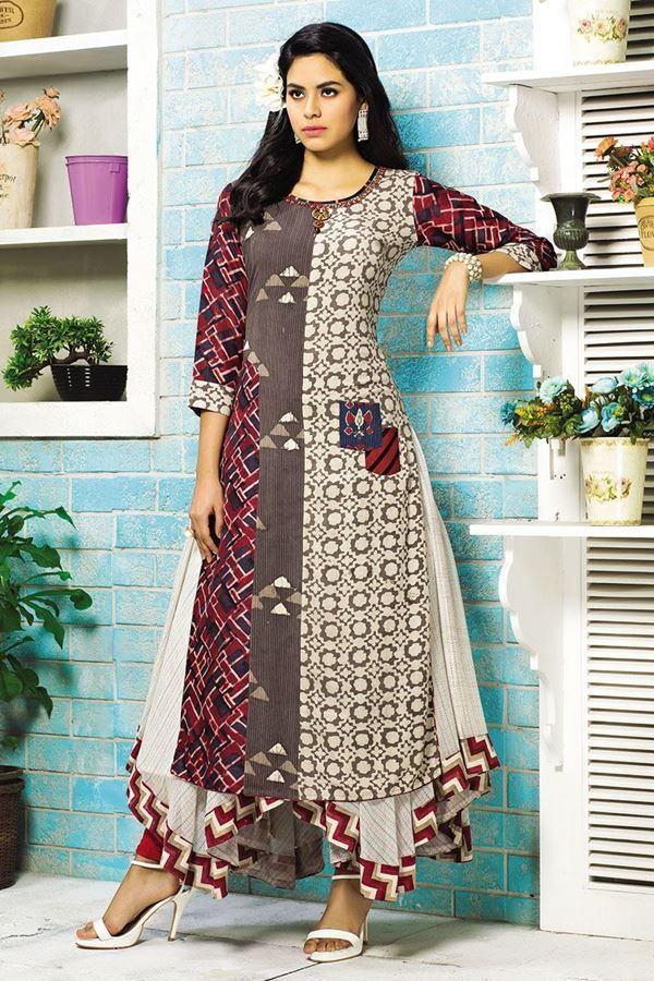 Look fabulous with this miraculous multicolor printed designer kurti featuring separate color & print panels going all along the straight cut upper layer enhanced at the neckline with a decorative broach while the inner falls in a gorgeous off-white handkerchief flare done in self patterning and enriched at the hem with zig-zag red printed border!
