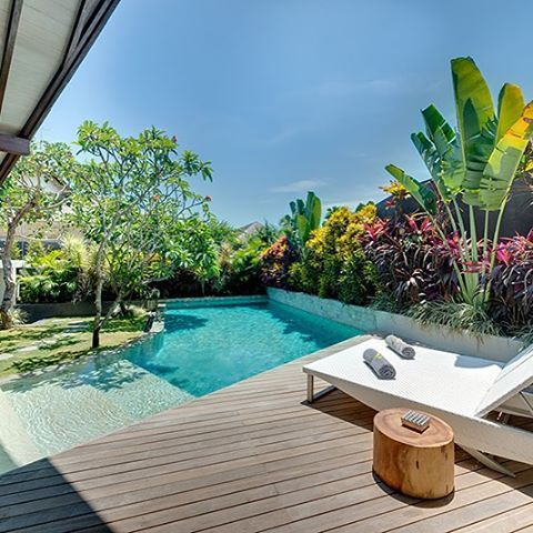 At each of The Layar's four one-bedroom villas, steps to the elevated garden follow the curve of the swimming pool to the open living and dining area spread out below the wing of the dramatically sloping ironwood-shingle roof. To one side of the living ar