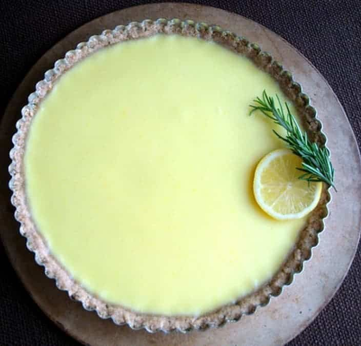 This lemon tart with rosemary crust is simple, tangy and creamy. Low sugar, made with wholesome spelt flour, rosemary an…
