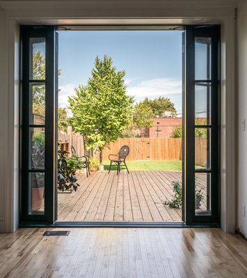 New exterior doors in a detached Edwardian home in west Hamilton. Replacing a narrow window in the corner these doors now open up to a 500 SF deck that spans the width of the house. #design #interiors #interiordesign  #designinspiration #inspiration #decor #homes