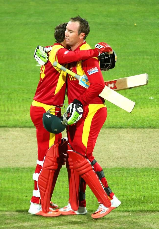 Brendan Taylor is congratulated by Sean Williams after completing his 7th ODI ton.Ireland vs Zimbabwe, 30th Match, Pool B