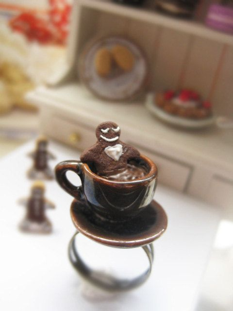 ★Christmas are awaiting in the next corner! Be prepared!★  ● Little handmade gingerbread man cookie is drowning in hot chocolate made of polymer clay.  ● Ceramic cup & small plate.  ● Adjustable nickelfree metal bronze ring.  Dimensions aprox: height of the ring 2,4cm.