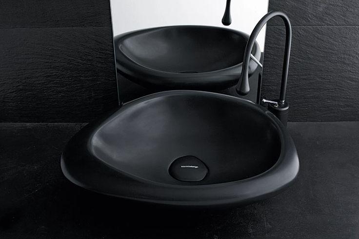 The particular shape of #Sasso creates a unique and fascinating atmosphere. #MastellaDesign #basin #washbasin #blackandwhite #bathdesign #bathroom #design