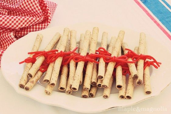 peel the twizzler strands apart and tie them around Pirouette cookies......voila, edible diplomas!