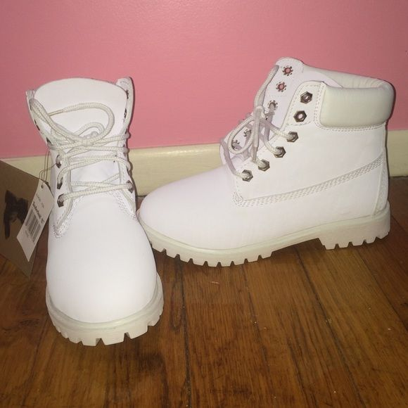 All White Timberland Boots bought them in the wrong size and never returned them, never worn Timberland Shoes Combat & Moto Boots