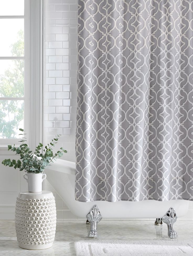 """Update your bathroom with a new shower curtain. A pretty pattern like this one on our Nuri Shower Curtain will revive your bath and help make it feel like a spa retreat. This 200 thread count cotton shower curtain features button holes for attaching curtain rings and is 72"""" long. Available at Home Decorators Collection."""