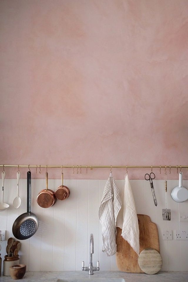 Pink wall kitchens and hanging shelves. Good Combo.