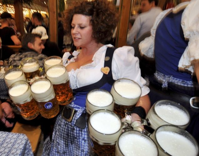 """Waitress Helga carries beer glasses in the """"Hofbraeuhaus"""" beer tent at the Theresienwiese Oktoberfest fair grounds in Munich, southern Germany, on September 24, 2012."""