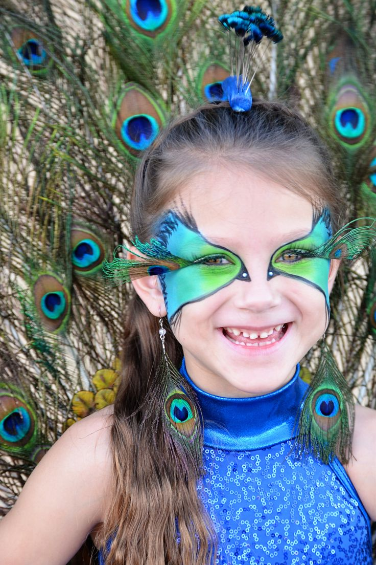 Prettiest Peacock Halloween costume EVER!  Instructions to make are HERE:  http://ideas.coolest-homemade-costumes.com/2012/10/31/best-homemade-peacock-costume-six-year-old-girl/