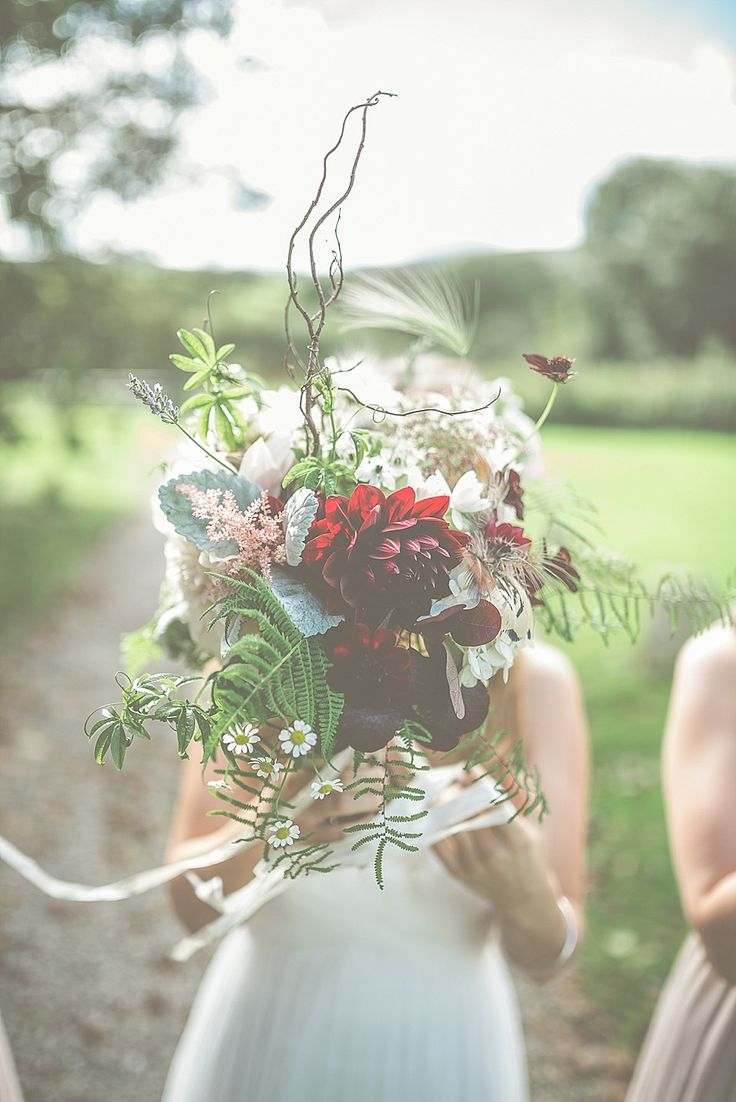 Seasonal, local flowers by the Blue Carrot. featuring dahlias, astilbe, and ferns. http://freshfromthefieldweddings.com/    Modern Vintage Wedding Photography