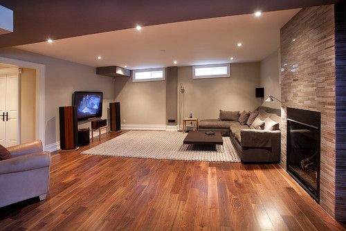 Basement remodel ideas wood flooring with area rug for Rugs for basement floors