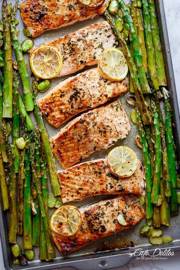 One Pan Lemon Garlic Baked Salmon + Asparagus: INGREDIENTS 6x 6 oz ( 170 g) salmon fillets, skin removed 2 tablespoons minced garlic 2 tablespoons fresh chopped parsley ⅓ cup freshly squeezed lemon juice Olive oil cooking spray 1 teaspoon Kosher salt (or sea salt flakes) ½ teaspoon cracked black pepper 4 bunches asparagus (24 spears), woody ends removed 1 lemon, sliced to garnish ⅓ cup beans/peas or any other greens