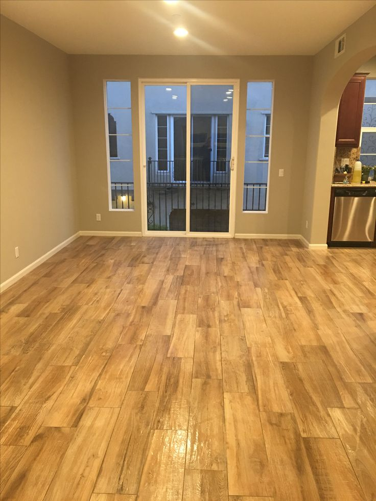 Beautiful Coastal Farmhouse Floors in this condo for sale in Corona, California. Benjamin Moore Revere Pewter wall color. Wood look porcelain tile Arizona Aequa Tur with Earth color grout. 4433owens102.com