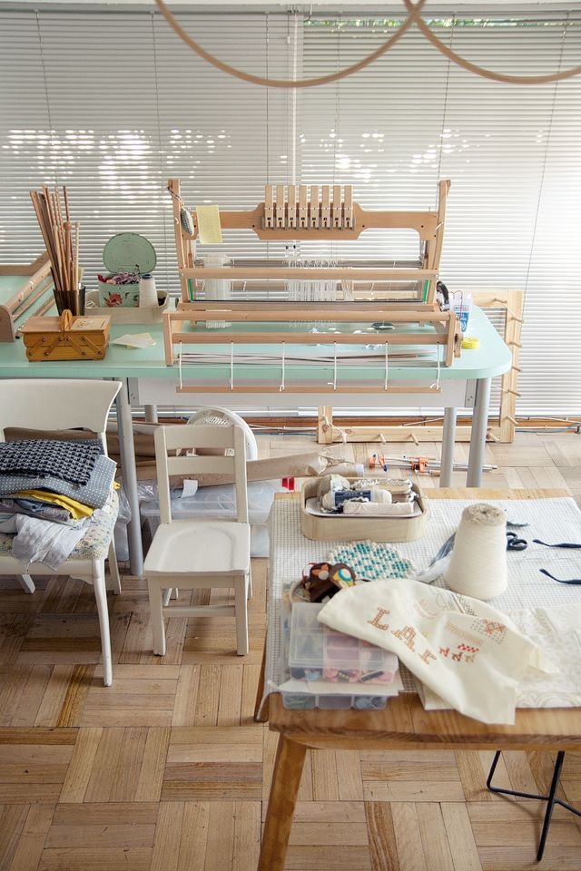 weaving space. love the colour of her desk.