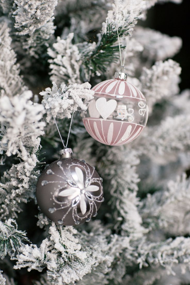 Blend frosted white trees with champagne or soft tones like pale blue, silver or dusty pink for a softer look!