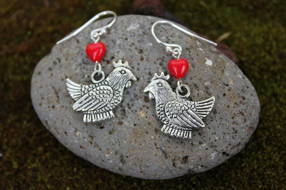 "These fun silver earrings celebrate everything there is to love about chickens! They feature silver tone fat hen charms under cute red glass hearts on nice quality sterling silver earring hooks. The chicken charm is about 3/4"" wide by 5/8"" tall. It is made from zinc alloy and is lead and nickel free and won't tarnish or change colors. Total earring length is 1 1/4"" from top of earring hook to bottom of the chicken charm.  I have these hearts in a big variety of colors (see last..."