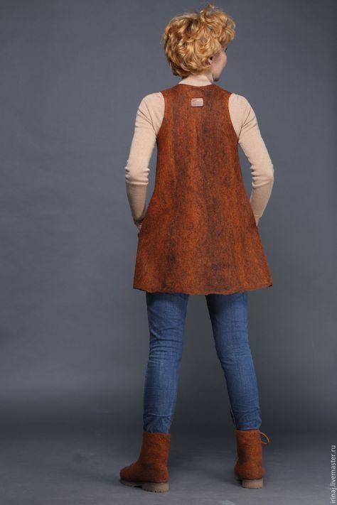 Купить или заказать валяный жилет 'Терракотовый' в интернет-магазине на Ярмарке Мастеров. Яркий, теплый, мягкий жилет из мериноса .Очень красивая расцветка - смесь рыжего с черным. Расклешенный силуэт. Прекрасно смотрится и с юбкой, и с брюками разной длины. Этот жилет сваляла для себя в цвет ботинок. Могу повторить.