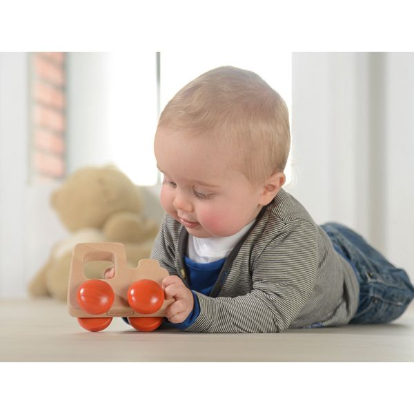 Natural and durable wooden toy car designed for little hands to grasp, hold and push. Made of FSC certified European beech and eco-friendly water-based finishes.