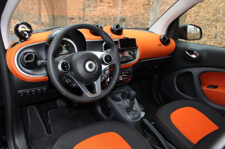 2015 Smart Fortwo interior with striking orange accents, black grey door panels dash and seats