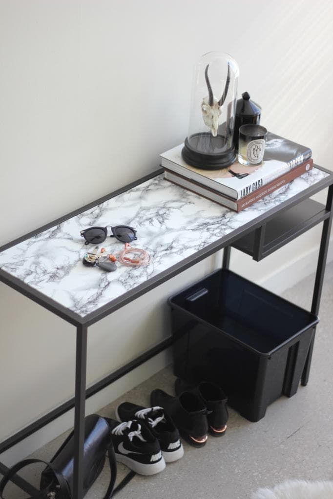 Marble contact paper elevates the minimalist VITTSJO table way above it's $40 price tag. Learn how easy this DIY upgrade is and take a table to a higher level yourself.