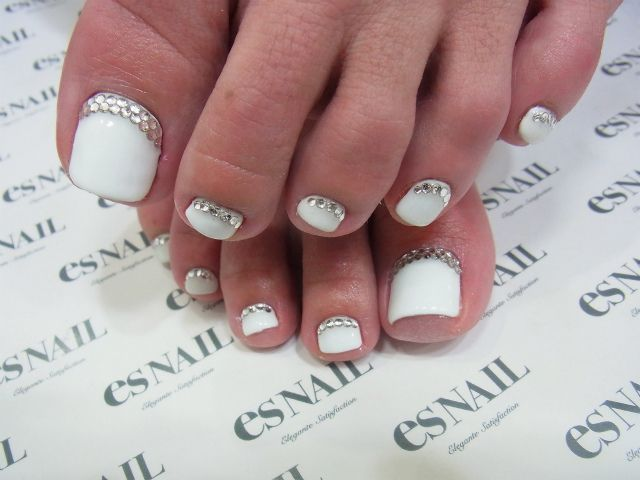 Wedding nails? White and silver. Maybe with red. And sparkles. Not gems.