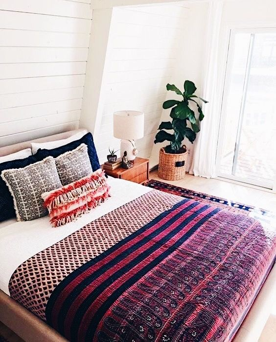 This is the only way we'd get away with having a white down comforter--cover most of it up with a decorative blanket.