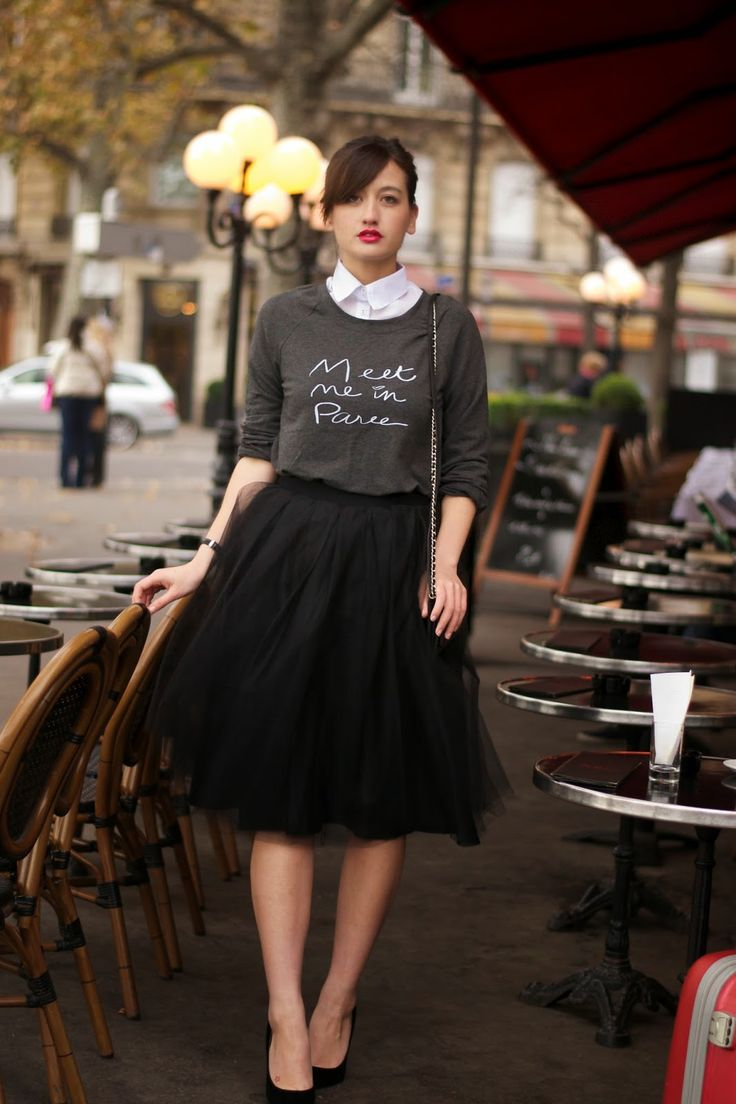 Graphic sweatshirt, white oxford, black tulle skirt, and black heels.