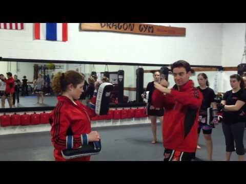 Holding Thai Pads - Muay Thai Kickboxing Classes  West Chester PA