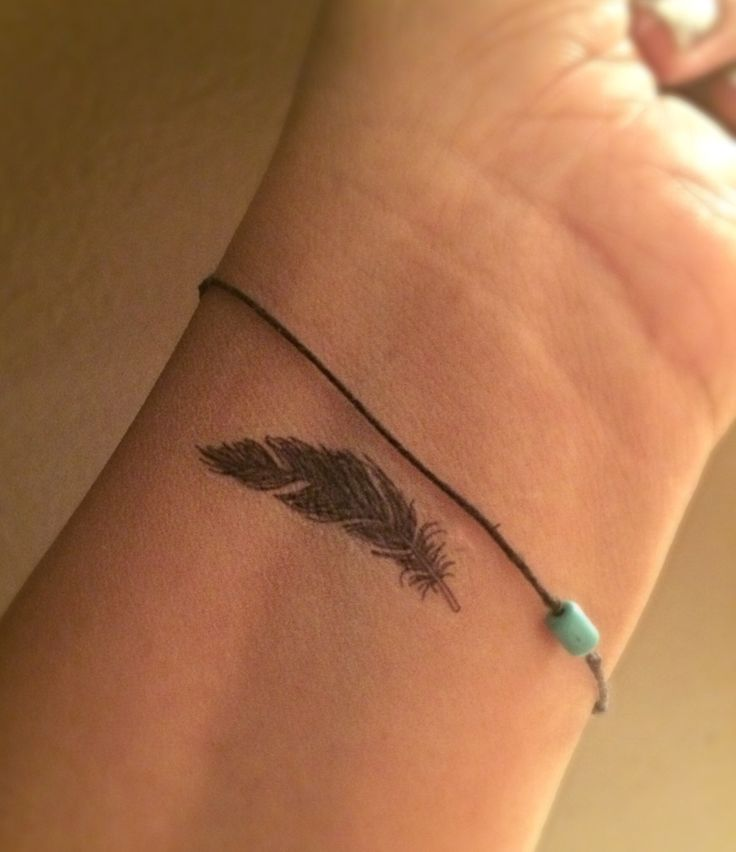 tiny feather tattoo