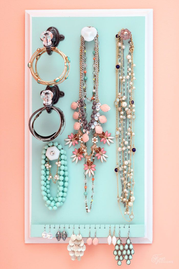 How to build a easy DIY Jewelry Organizer. Love this idea for organizing jewelry!