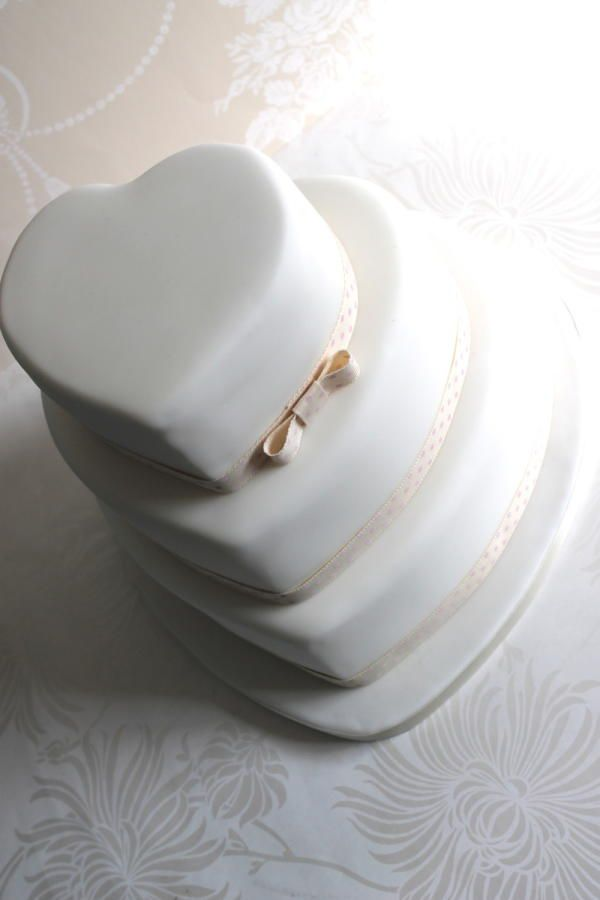 Plain and simple heart shaped wedding cake for more go to https://www.facebook.com/zoesfancycakes