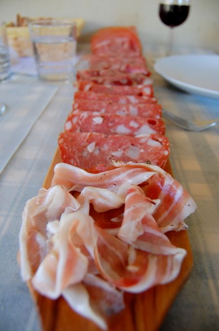 A selection of Tuscan meats including: Finocchiona (with wild fennel), Ginger Salsicce, Soppressata, Lardo di Colonnata, wild boar prosciutto.