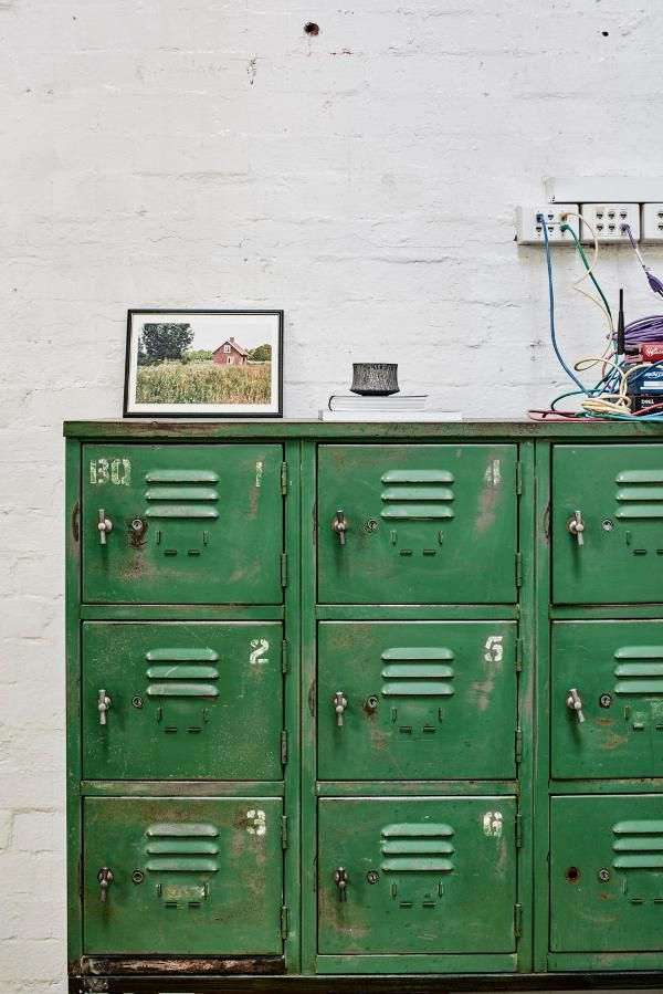 Upcylced lockers, provides a rustic touch to break up the ornate feel of the room