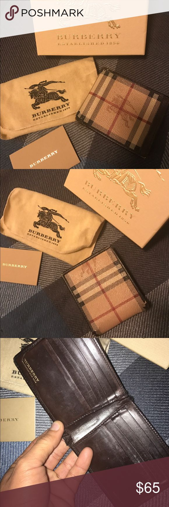 Authentic Burberry Wallet Men's Burberry Wallet Classic Haymarket check -8 slots for Credit card and also cash slot. Pre loved and does have some wear and tear -see photos for corners. Still has a lot of love for that Burberry lover. No box or bag included however will package up safely Burberry Accessories Key & Card Holders