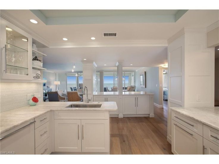 White cabinets, onyx countertops, driftwood floors