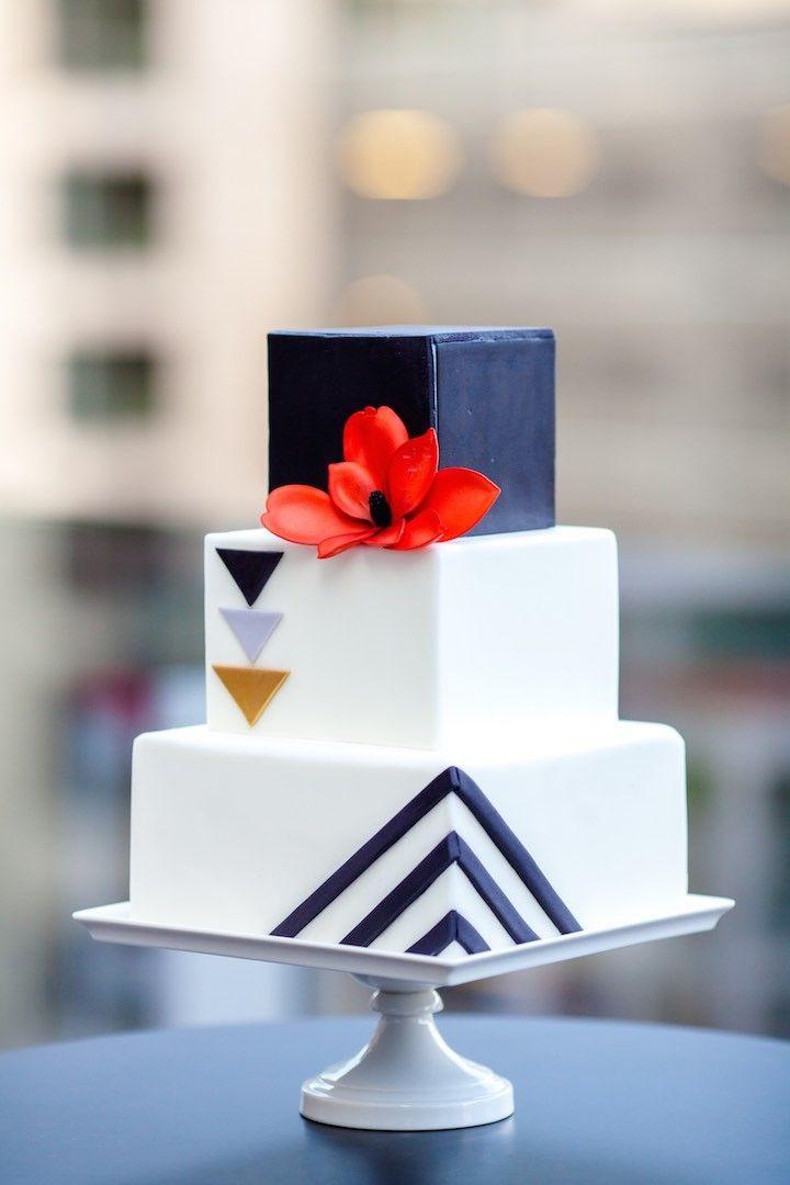 photo: Urban Safari Photography; modern striking wedding cake; Click to see more details of this gorgeous wedding