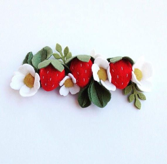 This sweet strawberry felt flower crown is made up of 3 felt strawberries, 5 strawberry flowers, and green leaves. They all lay on a 6 inch machine sewn felt headband base. Attached is an adjustable fold over elastic that expands and tightens to fit every head size, babies to adults!