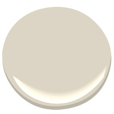 """Benjamin Moore Elmira White is Brad Ford's pick. It has subtle warmth with a modern edge. On the appeal of Elmira White, Ford notes: """"This is one of my favorite hues because it's both warm and bright without being too cheery. It's a perfect blend of beige and gray and will complement literally any color palette you choose to introduce in the room. You can't wrong with this one."""""""