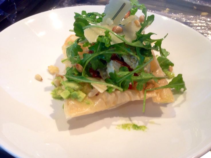 Artichoke, sundried tomato and feta tart with pine nut and rocket salad and avocado oil