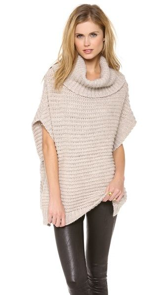 """DKNY Pure DKNY Chunky Melange Sweater: A neutral DKNY chunky knit sweater has an updated poncho feel; open sides that button under the arms. .Length 26"""" from shoulder ..."""