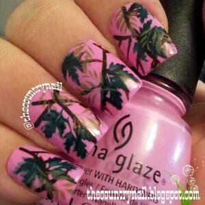 "Pink Mossy Oak Nails base is China Glaze ""Dance Baby"" pink, and for the designs, a combination of acrylic paints, stamping images, and green polish."